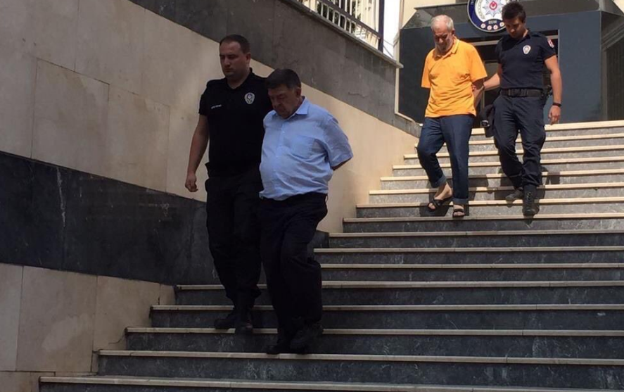 Veteran journalists handcuffed behind back whilst taken to courthouse