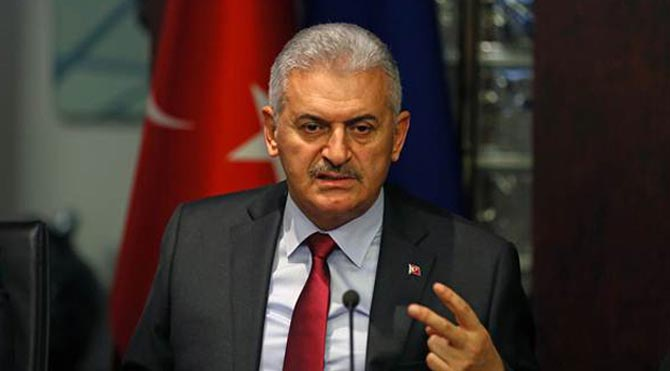 Turkish PM says nearly 82,000 sacked or suspended
