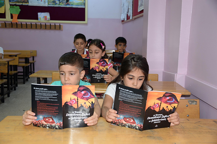 VIDEO: Coup brochures, videos by Education Ministry mark first day of school
