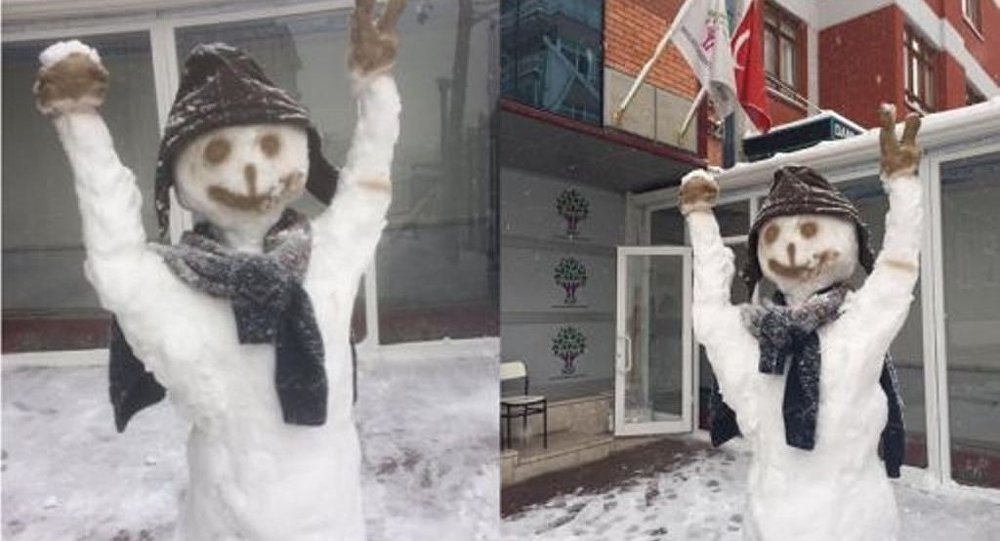 Police destroy 'Kurdish' snowman for flashing victory sign