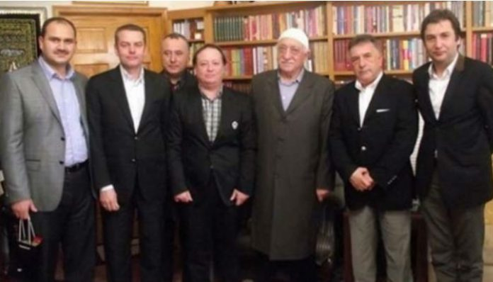 Doğan Holding says representative arrested for buttoning jacket during meeting with Gülen