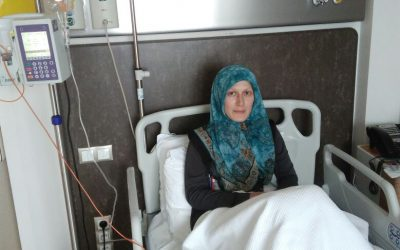 Turkish police wait at hospital to detain cancer patient