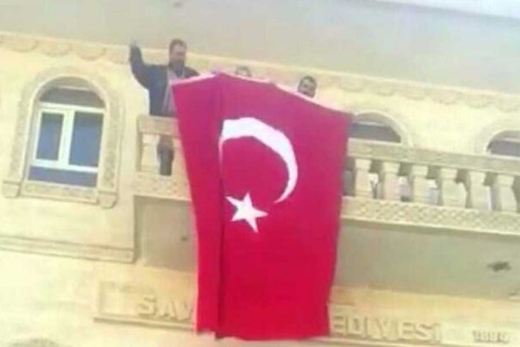 Police detain Kurdish mayor, hang Turkish flag on facade of town hall