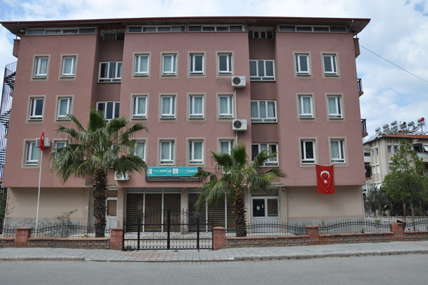 Pro-gov't foundation takes over seized dormitory in post-coup windfall
