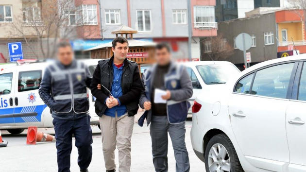 Turkey jails another 63 former police officers over mobile app