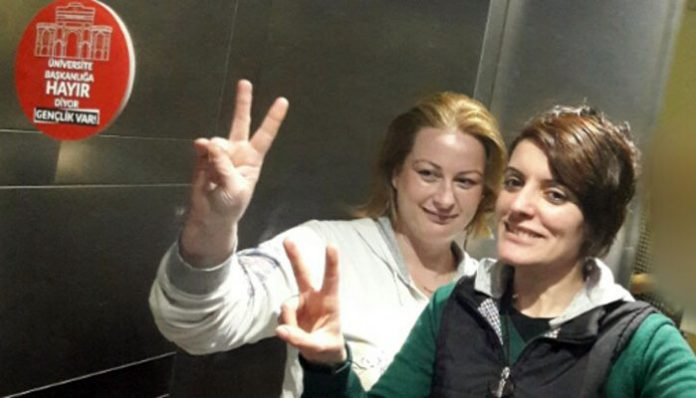 2 workers at university café fired for taking photo with 'no' sign for referendum