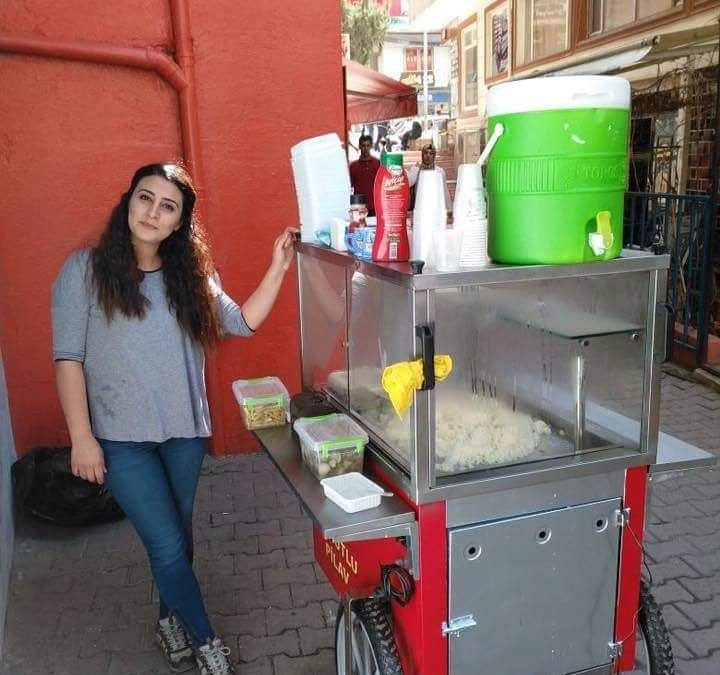 Teacher turned street vendor selling rice to passersby after dismissal in post-coup purge