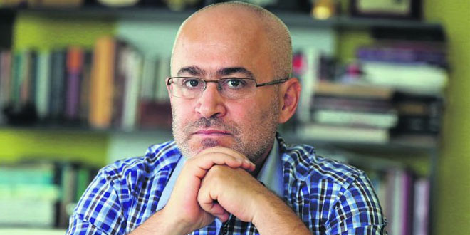 Turkish columnist faces life sentence for columns he didn't write