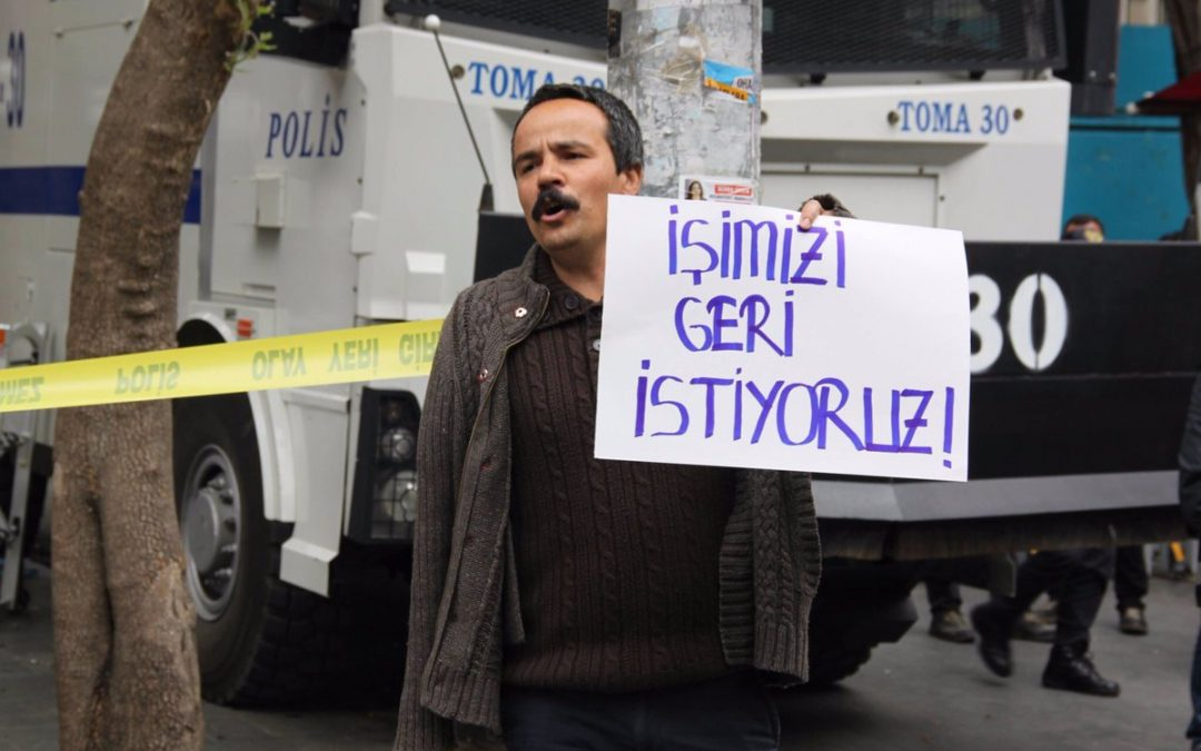 Police assault, detain purge victim man protesting post-coup dismissals