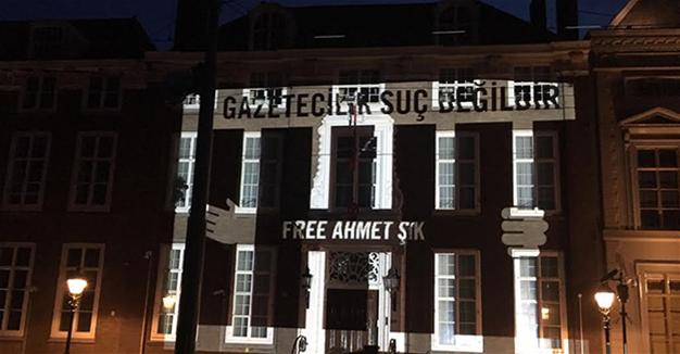 Amnesty projects names of jailed journalists onto Turkish embassy