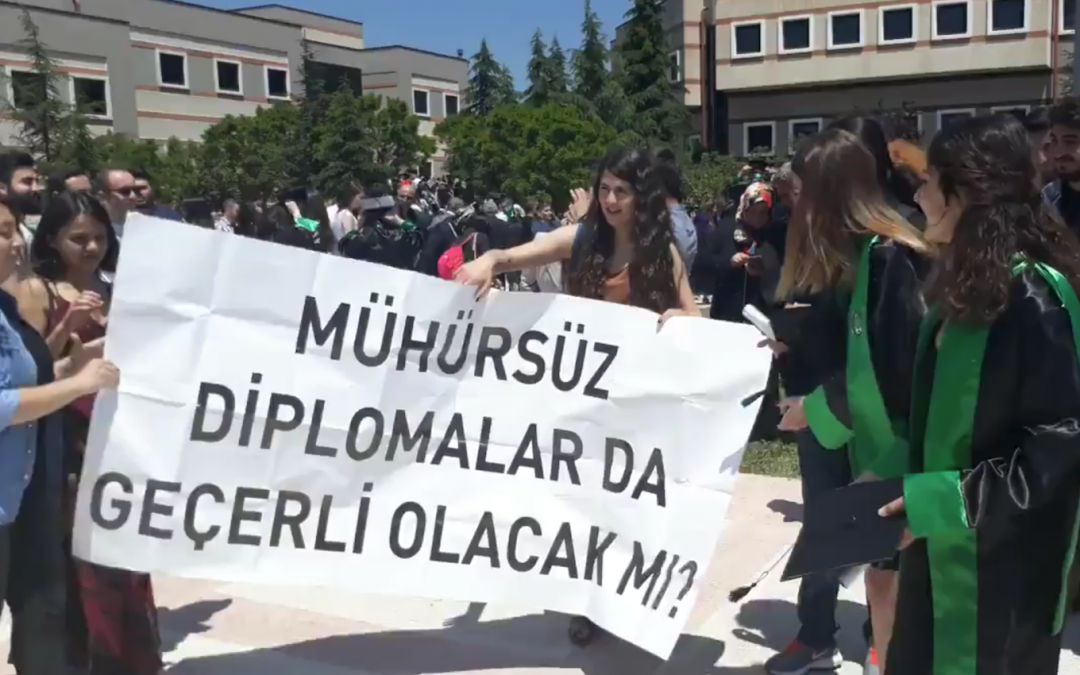 University security seize banner that questions authenticity of Erdogan's diploma