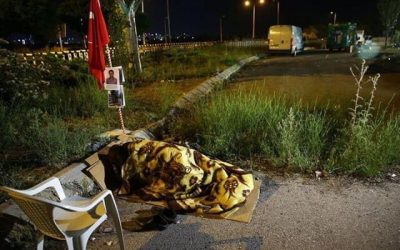 "60-year old man attends ""March of Justice,"" sleeps outside to protest son's arrest on coup charges"