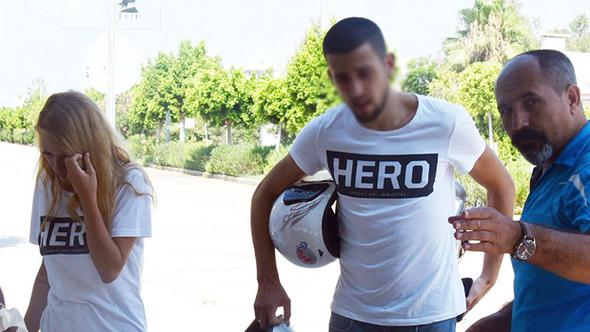 Police detain man, couple for wearing 'hero' T-shirts