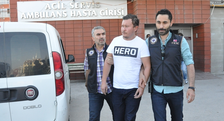 Police detain another man for wearing hero T-shirt
