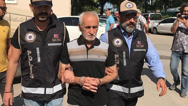 Retired public servant under custody for distributing donations to post-coup victims