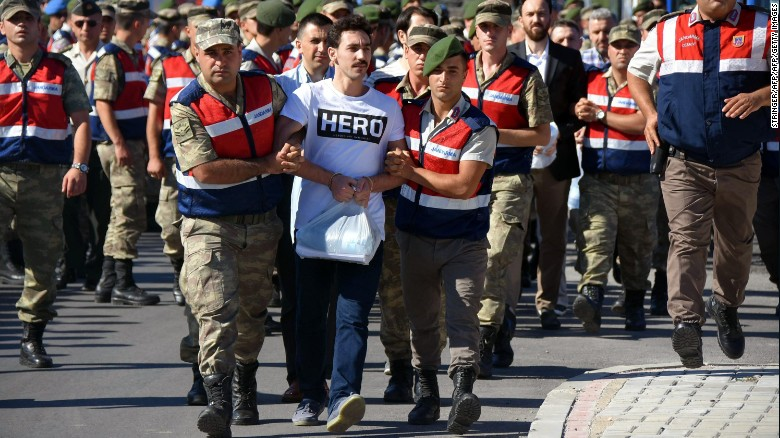 5 prison officials suspended over 'hero' T-shirt on coup suspect