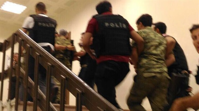 Turkey detains 23 more military members on coup charges