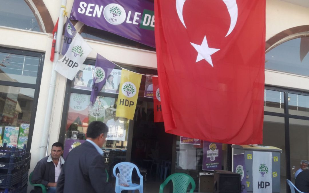 District governor covers pro-Kurdish party's election banners with Turkish flag