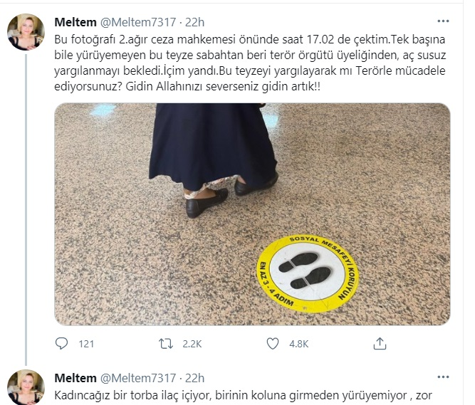 """Picture shows elderly woman with walking difficulty """"waiting to stand trial"""" on terror charges"""